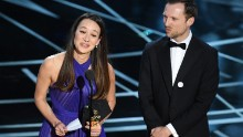 Producer Joanna Natasegara and director Orlando von Einsiedel accept the Oscar for best documentary (short subject).
