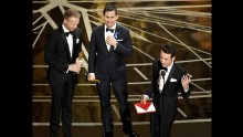 From left, songwriters Justin Paul, Benj Pasek and Justin Hurwitz accept the Oscar for best original song (