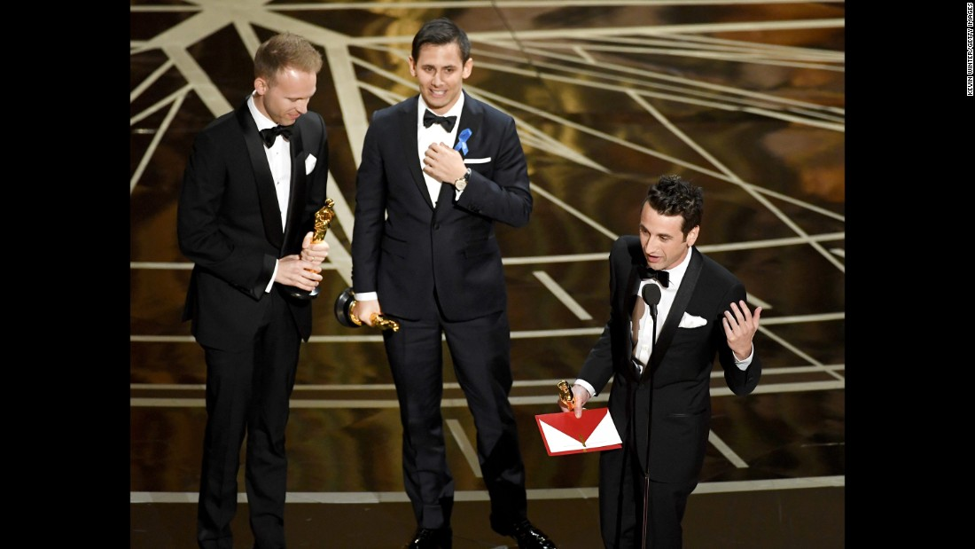 "From left, songwriters Justin Paul, Benj Pasek and Justin Hurwitz accept the Oscar for best original song (""City of Stars"" from the movie ""La La Land"")."