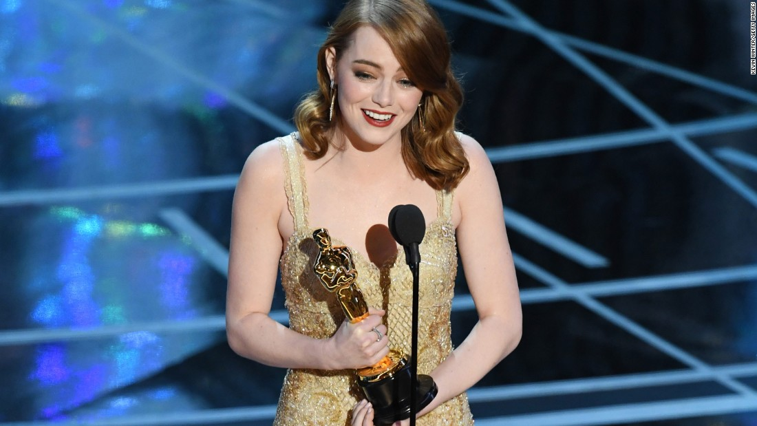 "Emma Stone accepts the best actress Oscar for her role in ""La La Land."""