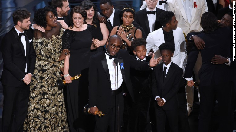 "Barry Jenkins, foreground center, and the cast accept the award for best picture for ""Moonlight."""