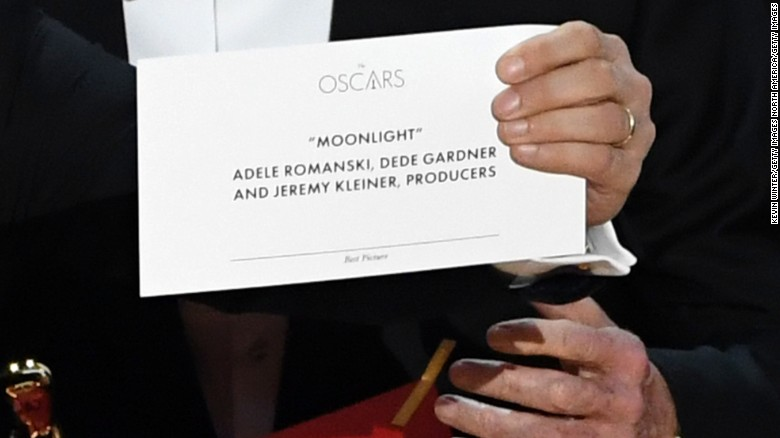 "Jordan Horowitz, producer of ""La La Land,"" shows the correct card that says ""Moonlight"" won best picture."