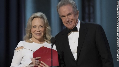 "Faye Dunaway, left, and Warren Beatty present the award for best picture, but the exterior on the envelope reads ""Actress in a Leading Role."""