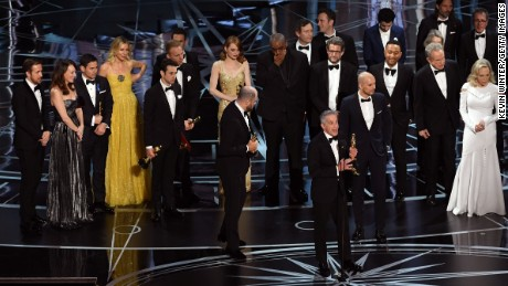 HOLLYWOOD, CA - FEBRUARY 26:  Prior to learning of a presentation error, 'La La Land' producers Marc Platt (speaking at microphone), Jordan Horowitz and Fred Berger accept the Best Picture award for 'La La Land' (later awarded to actual Best Picture winner 'Moonlight') onstage during the 89th Annual Academy Awards at Hollywood & Highland Center on February 26, 2017 in Hollywood, California.  (Photo by Kevin Winter/Getty Images)