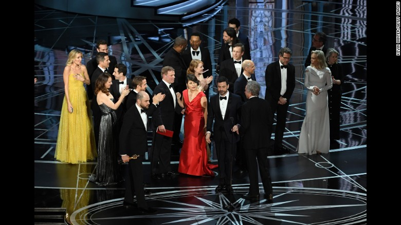 """La La Land"" producer Jordan Horowitz, lower left, stops the show to announce the actual best picture winner as ""Moonlight."""