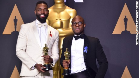 Writer/director Barry Jenkins (L) and writer Tarell Alvin McCraney pose in the press room with the Best Adapted Screenplay award for 'Moonlight' during the 89th Oscars on February 26, 2017 in Hollywood, California.  / AFP / FREDERIC J. BROWN        (Photo credit should read FREDERIC J. BROWN/AFP/Getty Images)