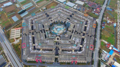 SHANGHAI, CHINA - JANUARY 20: (CHINA OUT) Image shows an aerial view of Shanghai Pentagonal Mart in Huinan Town of Pudong District on January 20, 2016 in Shanghai, China. A Pentagonal mart in Shanghai, a complex resembling the Pentagon in the US, has become the largest vacant building in Shanghai. Completed in 2009 with a total area of about 500,000 square meters, the Shanghai Pentagonal Mart has been left behind vacant mainly because of its location and confusing inner structures that barely any person can be caught sight of in this colossal building.  (Photo by VCG/VCG via Getty Images)