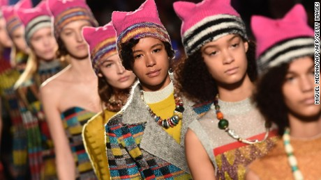 Models wearing pink hats walk the runway at the end of the show for fashion house Missoni during the Women's Fall/Winter 2017/2018 fashion week in Milan, on February 25, 2017.  Italian designer Angela Missoni brought the political fight to Milan fashion week by ending her autumn-winter 2017 show with models clad in Pussyhats, the pink protest symbols of women's rights. / AFP / Miguel MEDINA        (Photo credit should read MIGUEL MEDINA/AFP/Getty Images)
