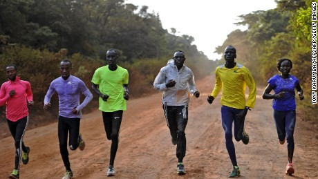 International Olympics Committee (IOC) 2016 olympics refugees team members run along a dirt road at a high altitude training camp, at the foot of the Ngong' hills, approximately 35km southeast of Nairobi, on July 25, 2016, in preparation for the 2016 Rio Olympic games.  The five from South Sudan who form the 10-member Team Refugee Olympic Athletics (ROA) selected by the International Olympic Committee in June, are hoping their participation at the Olympics would send a strong message to their native nation, South Sudan, after fresh political tensions erupted between the two warring factions led by President Salva Kirr and his former deputy Riek Machar, which left thousands dead and others displaced. / AFP / TONY KARUMBA        (Photo credit should read TONY KARUMBA/AFP/Getty Images)