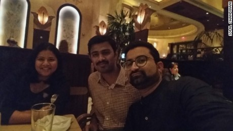 Shooting victim Srinivas Kuchibhotla (center), seen here at a Kansas City restaurant with his wife Sunayana and friend Somil Chandwani (right).
