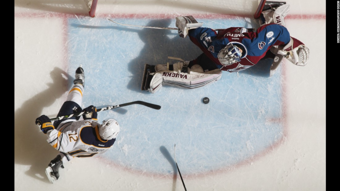 Colorado goalie Jeremy Smith makes a save on Buffalo's Brian Gionta during an NHL game in Denver on Saturday, February 25. Smith earned the first win of his career as the Avalanche defeated the Sabres 5-3.