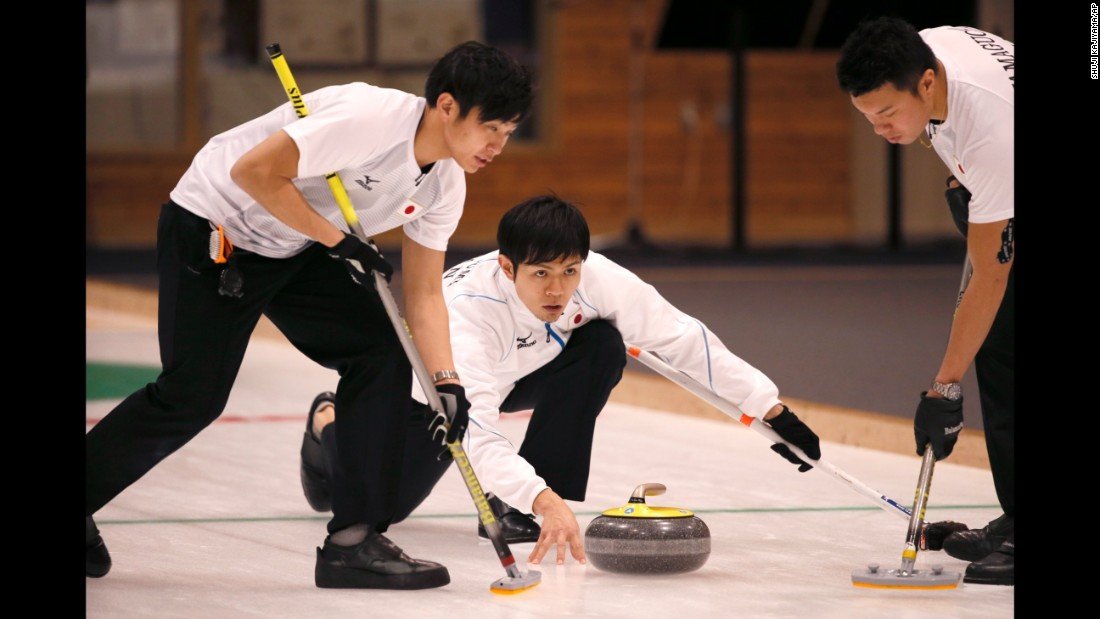 Japan's Yusuke Morozumi throws the stone during the curling final of the Asian Winter Games on Friday, February 24. China won the final 11-4.