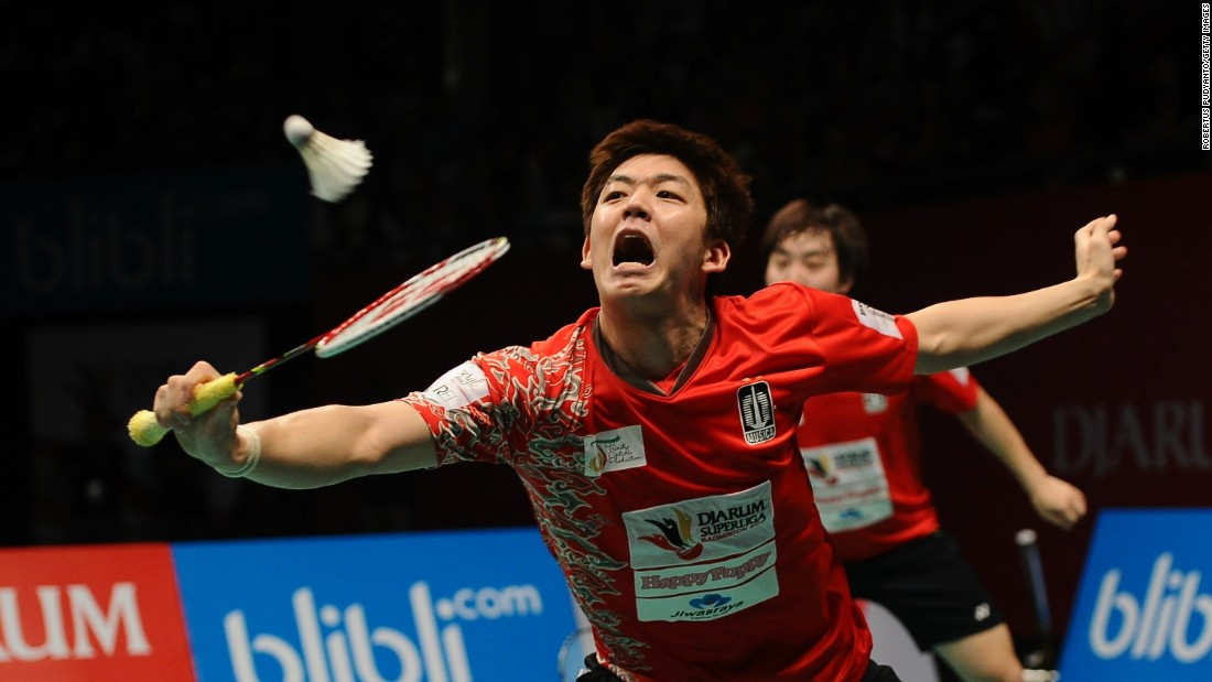 Lee Yong-dae plays a shot during a badminton match in Surabaya, Indonesia, on Sunday, February 26.