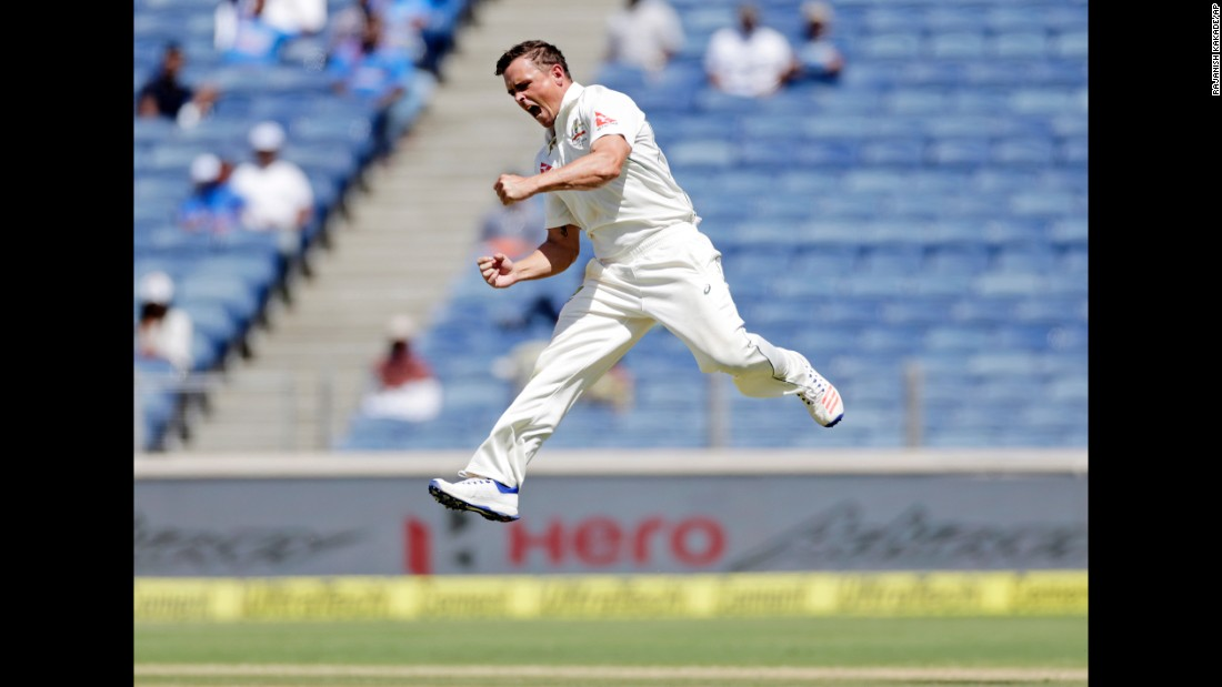 Australia's Steve O'Keefe celebrates the dismissal of India's Virat Kohli during a cricket match in Pune, India, on Saturday, February 25.