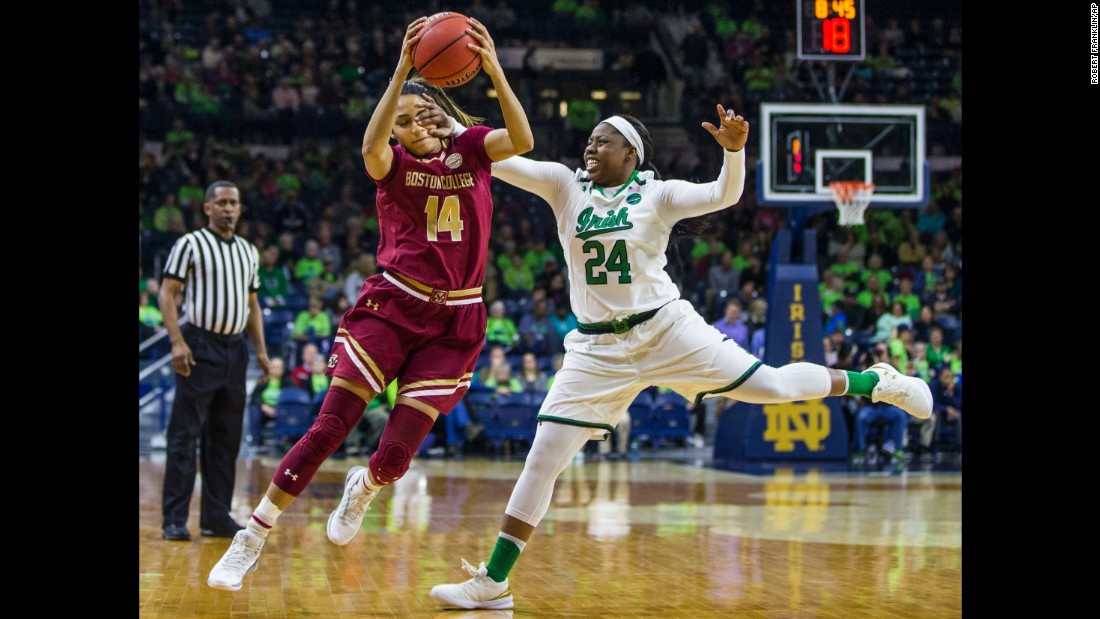 Boston College's Kailey Edwards is hit in the face by Notre Dame's Arike Ogunbowale as she grabs a pass in South Bend, Indiana, on Thursday, February 23.