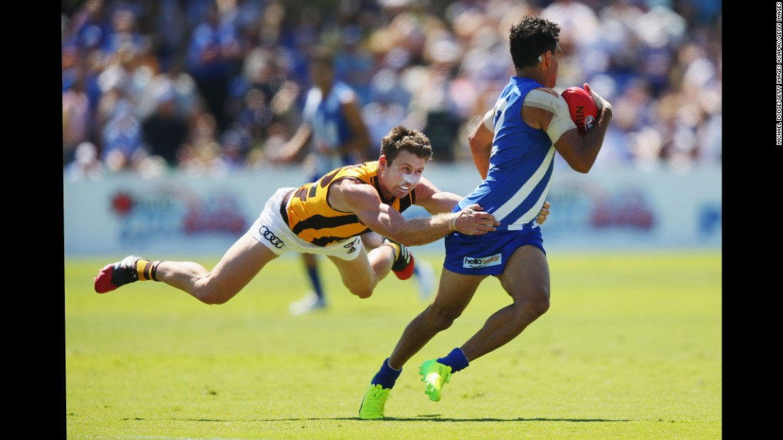 Hawthorn's Liam Shiels tackles North Melbourne's Lindsay Thomas during an Australian Football League match on Sunday, February 26.