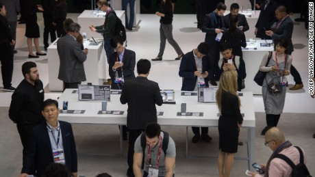 Visitors test various LG devices at company's booth during the Mobile World Congress on the first day of the MWC in Barcelona,  on February 27, 2017. / AFP / Josep Lago        (Photo credit should read JOSEP LAGO/AFP/Getty Images)