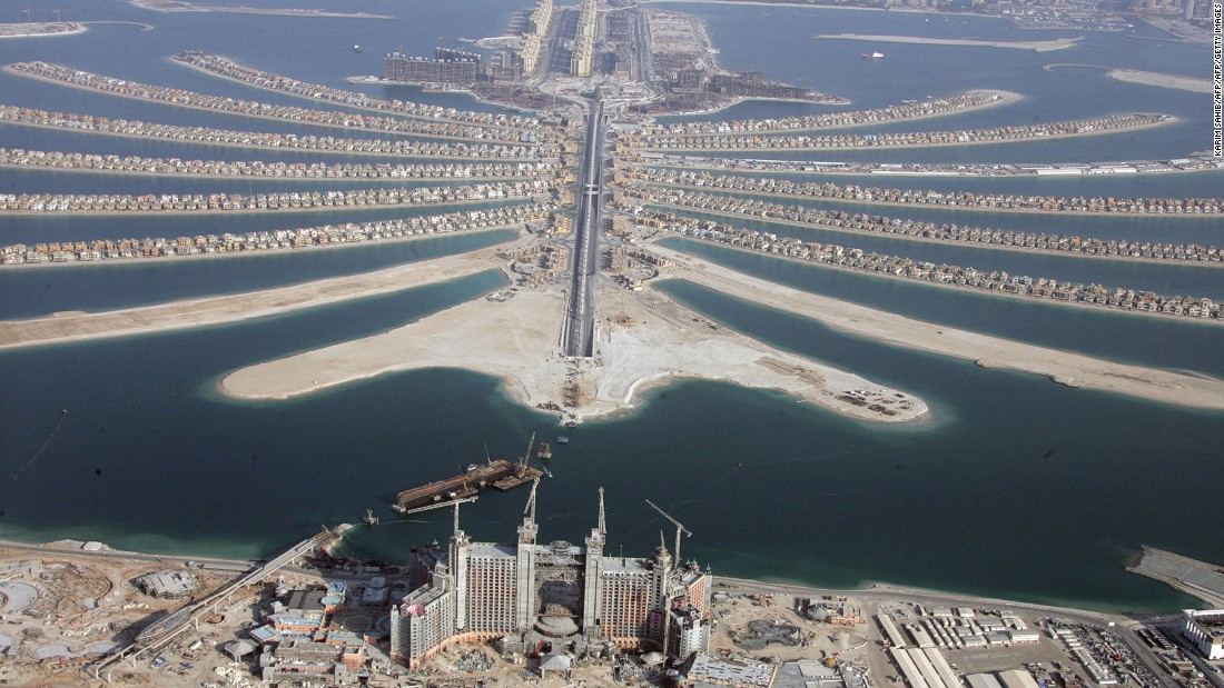 This is a view of the Palm Islands in 2007. The islands house hotels, spas, beaches and residential buildings. In the foreground is the luxury hotel Atlantis The Palm, still under construction at this time.