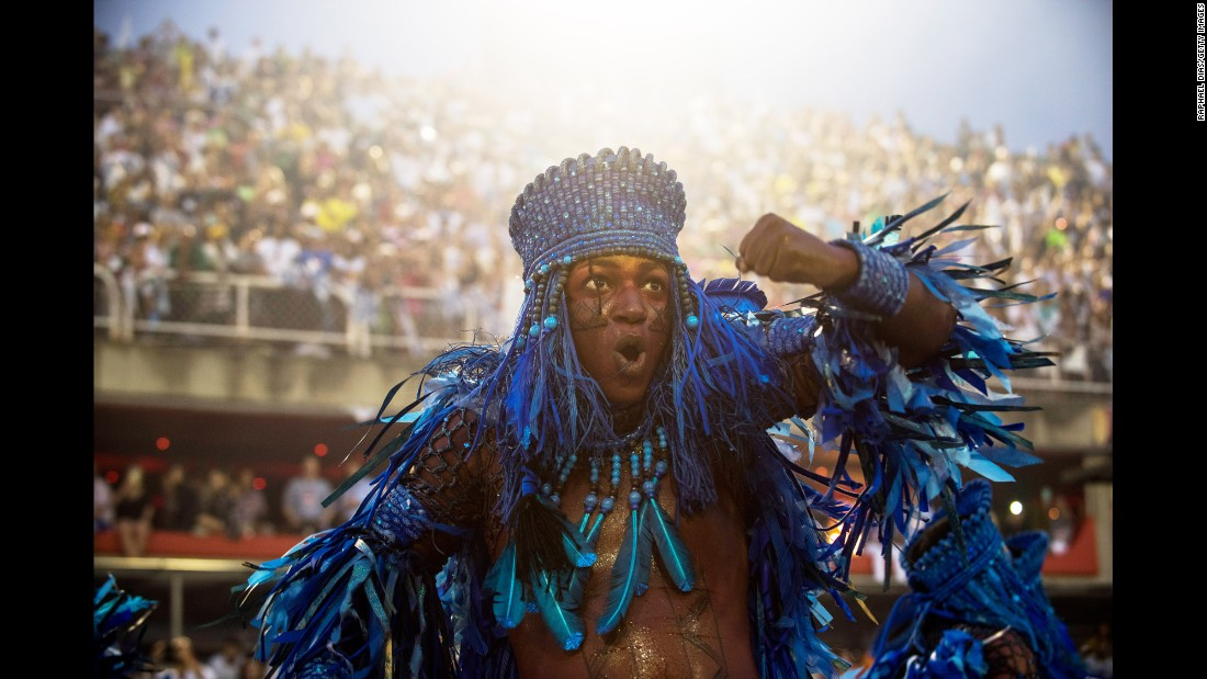 <strong>Rio de Janeiro, Brazil: </strong>A performer from the Beija Flor samba school plays to the crowds at the Sambodrome in Rio de Janeiro on February 26. Around the world, people have been taking part in a wide range of carnival celebrations related to Shrove Tuesday and the arrival of spring.