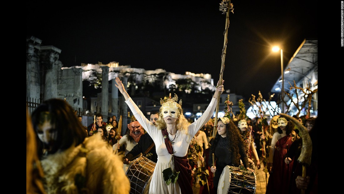 <strong>Athens, Greece: </strong>Parade-goers march through Athens' Monastiraki district in Athens to celebrate an ancient Greek festival honoring Dionysus, the god of wine, festivity and theater.