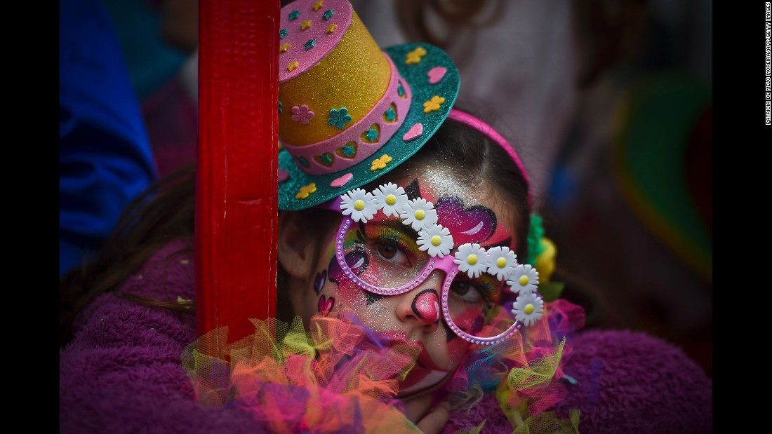 <strong>Sesimbra, Portugal: </strong>A child dressed as a clown watches the celebrations in Sesimbra. In 2004, the town made it into the Guinness Book of Records for staging the world's largest clown parade.