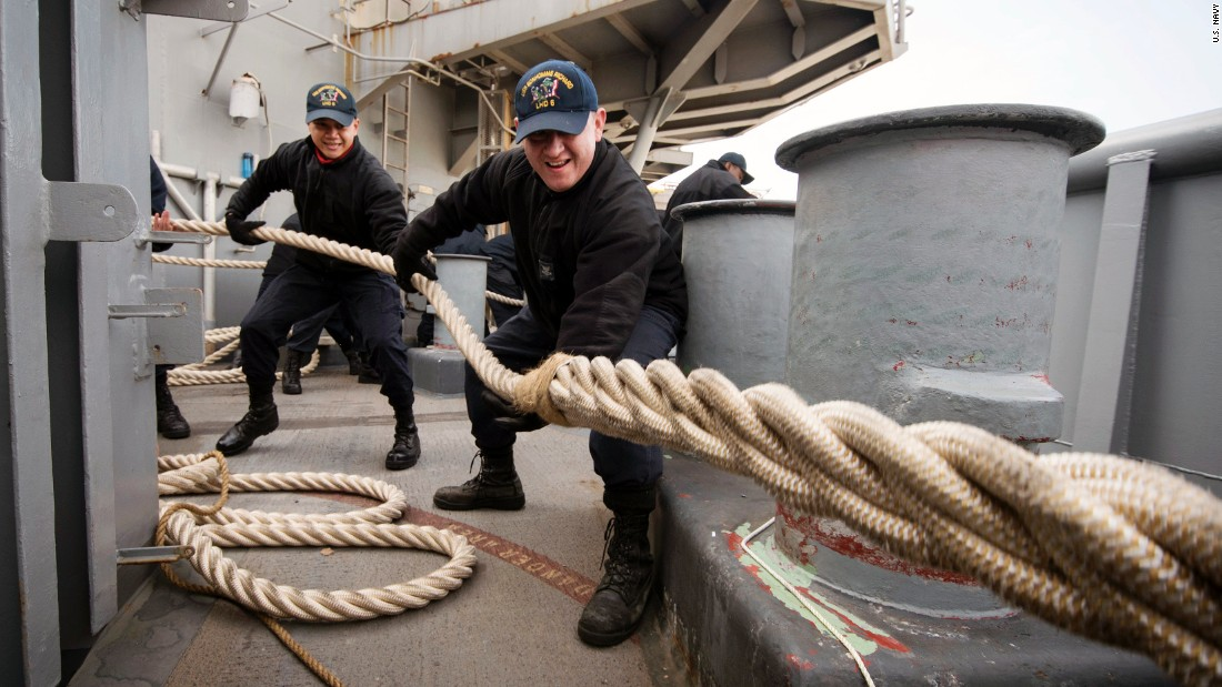Two sailors heave a mooring line on the fantail of the USS Bonhomme Richard as the amphibious assault ship prepares to leave Sasebo, Japan, on Monday, February 27. The ship was on a routine patrol in the region.