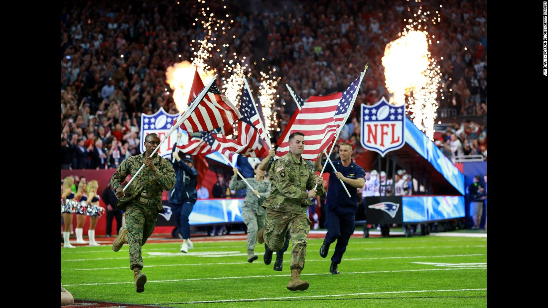 "Members of the US military run with American flags before the start of <a href=""http://www.cnn.com/2017/02/05/sport/gallery/super-bowl-li/index.html"" target=""_blank"">Super Bowl LI </a>on Sunday, February 5."