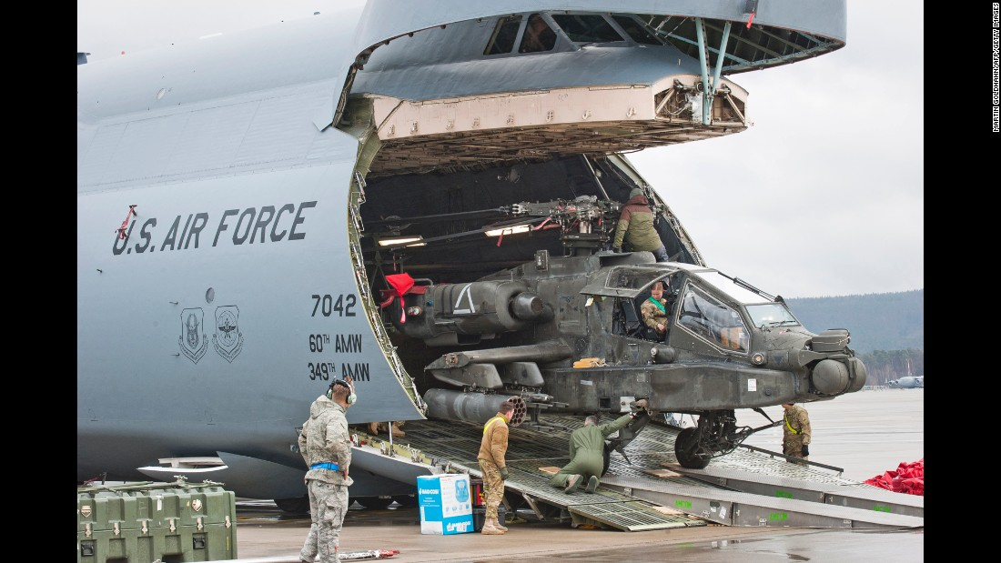 A helicopter is unloaded from a transport plane at Ramstein Air Base, a US Air Force facility in western Germany, on Wednesday, February 22.