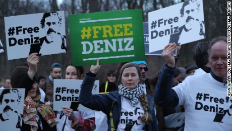 Protesters gather outside the Turkish Embassy in Berlin on Tuesday to demand Yucel's release.