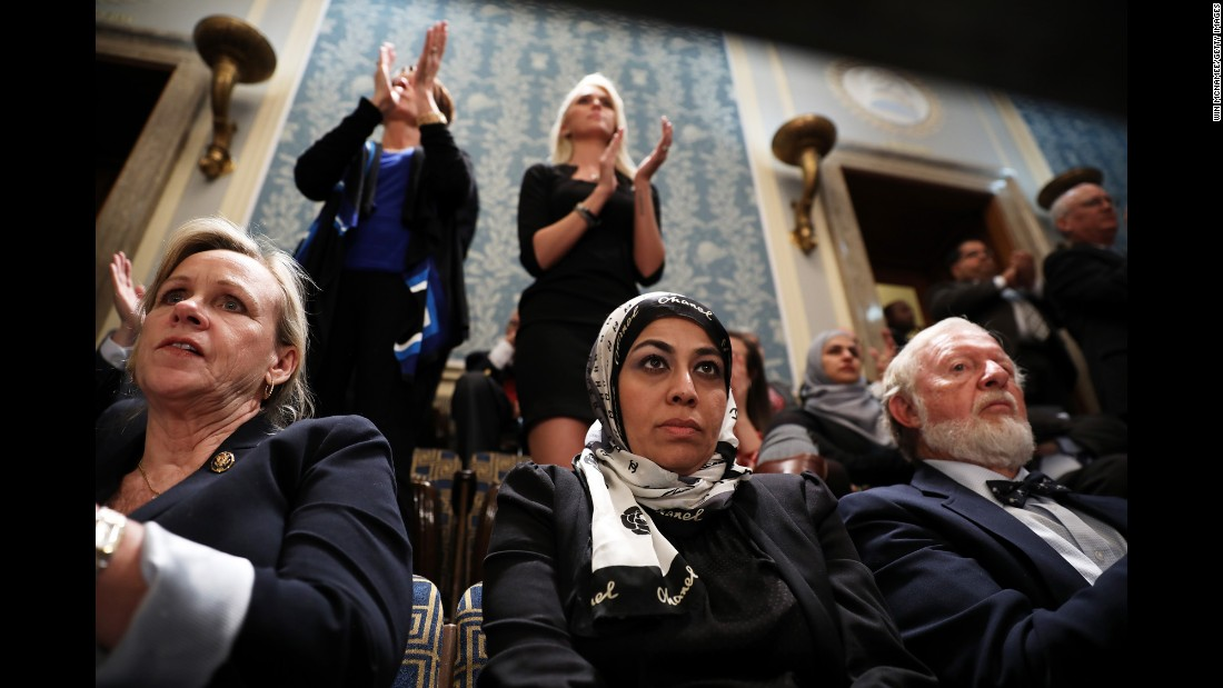 Muslim activist Fauzia Rizvi, a guest of US Rep. Mark Takano, watches Trump's address.