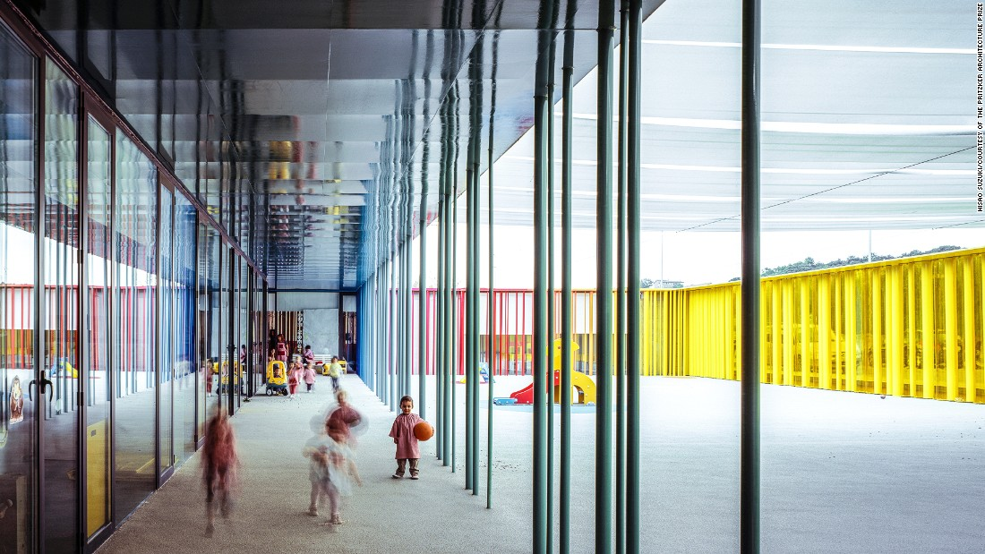 This kindergarten is built using colorful vertical tubes to create a rainbow effect. Some of the tubes can be rotated by children for fun.