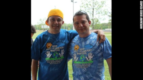 Hernandez, left, with friend Mark Williams, right, as the two participated in a community event.
