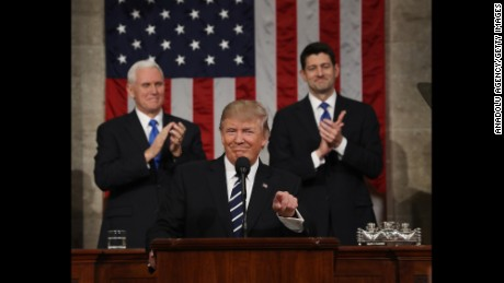 "WASHINGTON, USA - FEBRUARY 28: (----EDITORIAL USE ONLY  MANDATORY CREDIT - ""JIM LO SCALZO / EPA / POOL"" - NO MARKETING NO ADVERTISING CAMPAIGNS - DISTRIBUTED AS A SERVICE TO CLIENTS----) US Vice President Mike Pence (L) and Speaker of the House Paul Ryan (R) applaud as US President Donald J. Trump (C) arrives to deliver his first address to a joint session of Congress from the floor of the House of Representatives in Washington, United States on February 28, 2017. Traditionally the first address to a joint session of Congress by a newly-elected president is not referred to as a State of the Union.