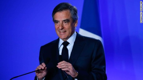Conservative presidential candidate Francois Fillon adjusts microphones before a press conference at his campaign headquarters in Paris, Wednesday, March 1, 2017. Fillon's campaign for the French presidency faced new uncertainty Wednesday as he abruptly canceled a campaign stop at the country's premier farm fair and an investigation intensified into alleged fake parliamentary jobs for his family. (AP Photo/Francois Mori)