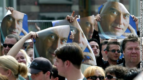 People hold up posters of Pim Fortuyn in Rotterdam, days after he was assasinated May 2002.