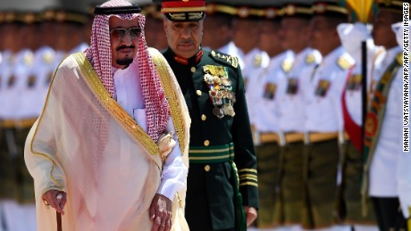 Saudi King Salman bin Abdulaziz (L) inspects a ceremonial guard of honour during a welcoming ceremony at the Parliament House in Kuala Lumpur on February 26, 2017. / AFP / MANAN VATSYAYANA        (Photo credit should read MANAN VATSYAYANA/AFP/Getty Images)