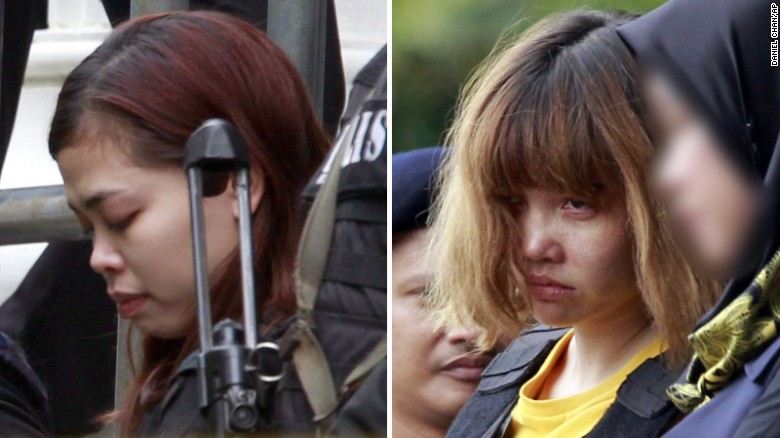 Police escort two women charged in the case -- Siti Aisyah, left, and Doan Thi Huong -- on  March 1.
