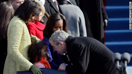 President George W. Bush greets Sasha Obama at the inauguration of Barack Obama on January 20, 2009, in Washington.