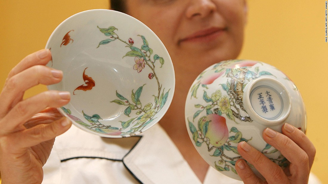 "Pola Antebi, head of Chinese ceramics and works of art at Christie's Hong Kong, holds up a pair of famille-rose ""peach"" bowls.  The small bowls, dated between 1723-1735, sold for more than $6.5 million (HK$50,720,000) at a Christie's 2007 auction."
