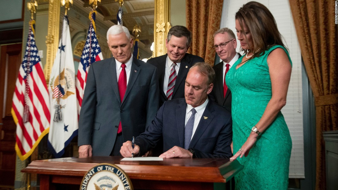 "New Interior Secretary Ryan Zinke signs an official document after he was <a href=""http://www.cnn.com/2017/03/01/politics/ryan-zinke-confirmation-vote-interior-secretary/"" target=""_blank"">confirmed by the Senate</a> on Wednesday, March 1. The former congressman from Montana was joined by his wife, Lolita, as well as Vice President Mike Pence, US Sen. Steve Daines and Montana Attorney General Tim Fox."