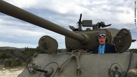 When driving a tank, CNN's Richard Roth prefers business attire.