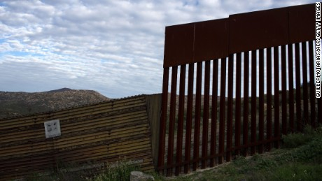 A photo of the US/Mexico border wall in Tecate, northwestern of Mexico on February 14, 2017. Attention Editors, this image is part of an ongoing AFP photo project documenting the life on the two sides of the US/Mexico border simultaneously by two photographers travelling for ten days from California to Texas on the US side and from Baja California to Tamaulipas on the Mexican side between February 13 and 22, 2017. You can find all the images with the keyword : BORDERPROJECT2017 on our wire and on www.afpforum.com  / AFP / GUILLERMO ARIAS        (Photo credit should read GUILLERMO ARIAS/AFP/Getty Images)