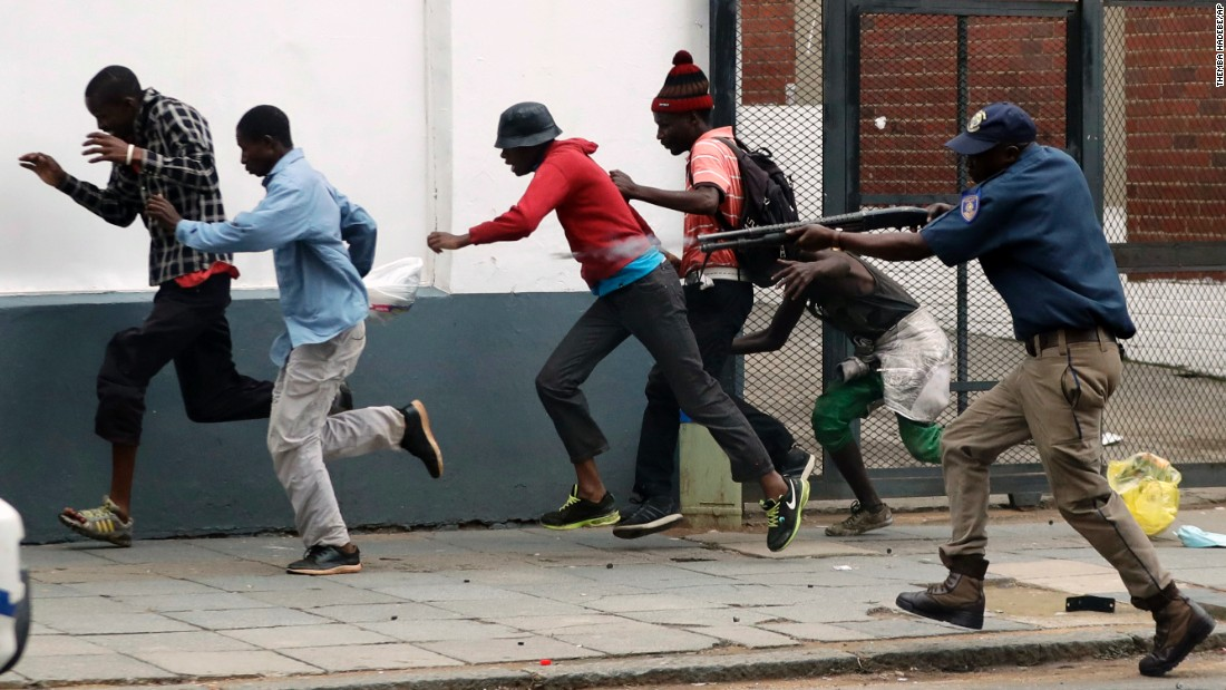 "A police officer fires rubber bullets at anti-immigrant protesters in Pretoria, South Africa, on Friday, February 24. Rampant unemployment and high crime rates have stoked anger against foreign migrants. Some South Africans <a href=""http://www.cnn.com/2017/02/24/world/south-africa-anti-immigrant-protests/"" target=""_blank"">have attacked foreign-owned shops in the city.</a>"
