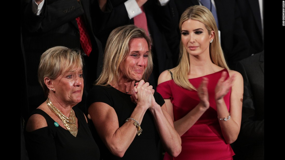 "Carryn Owens, center, cries as <a href=""http://www.cnn.com/2017/02/28/politics/navy-seal-widow-trump-address/"" target=""_blank"">she is applauded during President Trump's address to Congress</a> on Tuesday, February 28. Owens' husband, Navy SEAL William ""Ryan"" Owens, recently was killed during a mission in Yemen. ""Ryan died as he lived: a warrior and a hero, battling against terrorism and securing our nation,"" Trump said. The applause lasted over a minute, which Trump said must be a record."