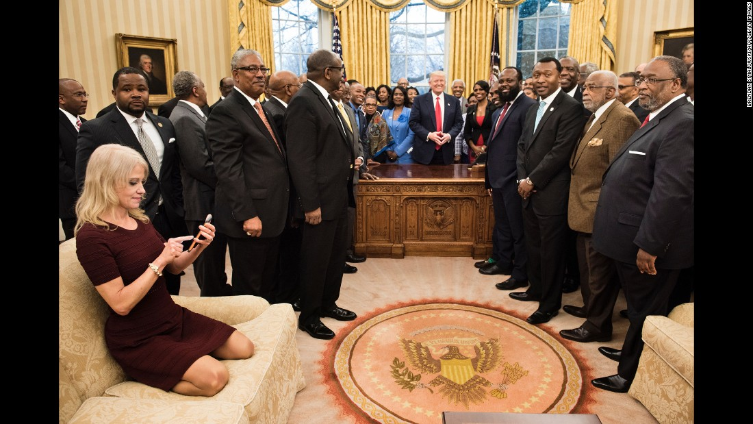 "White House Adviser Kellyanne Conway checks her phone after taking an Oval Office photo of President Trump and leaders of historically black colleges and universities on Monday, February 27. The image of her kneeling on the couch <a href=""http://www.cnn.com/videos/politics/2017/02/28/kellyanne-conway-oval-couch-photo-orig-vstan.cnn"" target=""_blank"">sparked memes on social media.</a>"