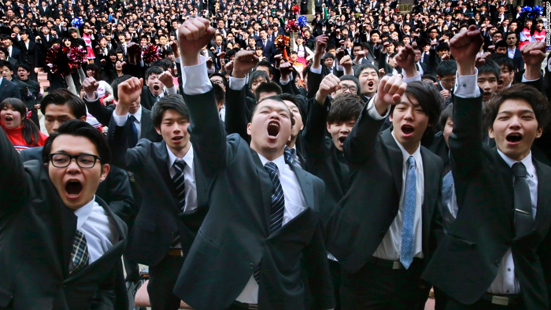 College students raise clenched fists during a joint pep rally to launch their job hunt Wednesday, March 1, at Tokyo's Hibiya Park.
