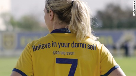 Midfielder Lisa Dahlkvist wears a shirt which says 'Believe in your damn self' -- a tweet by singer Zara Larsson