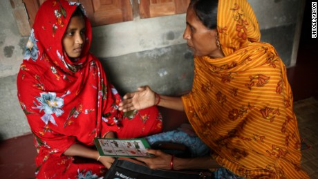 A social worker provides counseling to a teenage girl in Ashkarpur, Bangladesh, in 2013.