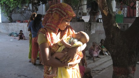 Sharmin, pictured in 2010, lived on the streets with a newborn after her husband abandoned her.