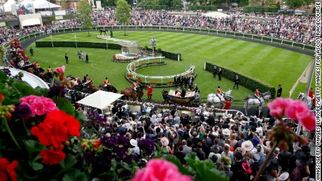 ASCOT, ENGLAND - JUNE 20:  General view of atmosphere taken from the Parade Ring Restaurant of the royal procession inside the Parade ring during Royal Ascot 2015 at Ascot racecourse on June 20, 2015 in Ascot, England.  (Photo by Tristan Fewings/Getty Images for Ascot Racecourse)